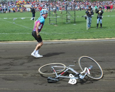 Several accidents left racers injured but unwavering in their attempt to win. This racer dragged his bike off the track but quickly rejoined the race.
